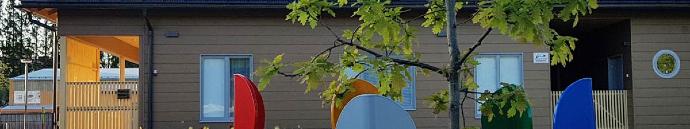 puunrunkosuoja kuhmoisten päiväkodilla